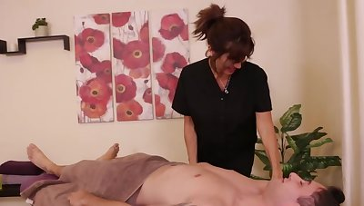 Client doesn't expect the dominant masseuse to take him a handjob