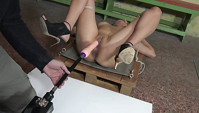 Slave girl Adina Rimers gets her pussy pleasured less a fuck machine