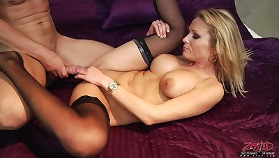 Blonde darling Laura Spyglass spreads their way arms near ride a cock