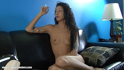 Tattooed matured cougar smoking space fully displaying her natural interior