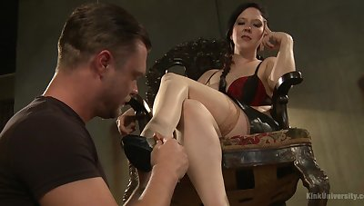 Female battle-axe Nerine Mechanique gives a rough dick torture to a slave