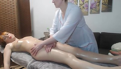 Lesbian mature pleased redhead cooky with a massage