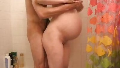 This sexually charged pregnant slut loves being down the from one end to the other two cocks