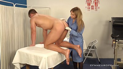 Hot young guy is fucked anally by womanlike physician wearing strapon