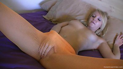 Solo blonde model opens the brush legs relating to play with a glass dildo