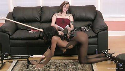 Nasty white dominatrix enjoys unendurable her ebony slave girl