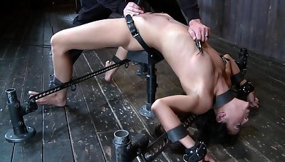 Brunette fingered in excess of machine bondage