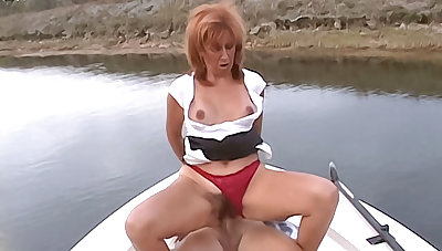 Smoking hot redhead cougar with big tits sucks a hard cock then has her hairy pussy pounded